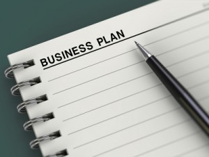 Notebook with business plan title and pen. Good for business concept